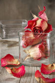 Dried roses in jar — Stock Photo