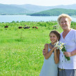 Great grandmother and great granddaughter in meadow — Stock Photo #77431732