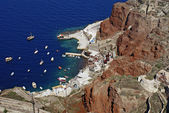 Old port of Oia village at Santorini island in aegean sea, Greec — Stock Photo