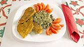Delicious Wiener Schnitzel with lemon and tomatoes — Stock Photo
