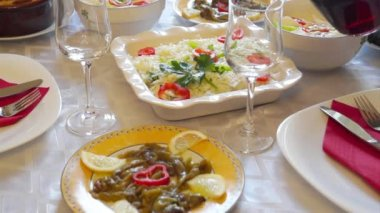 Traditional Greek salads and red wine — Stockvideo