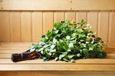 Bunch of green birch twigs in sauna — Stock Photo