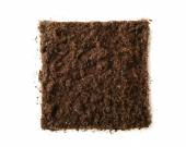 Square piece of soil isolated on white — Stock Photo