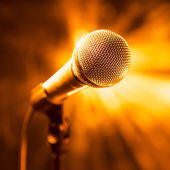 Golden microphone on stage — Stock Photo