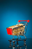 Shopping cart full of money — Stock Photo