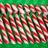 Candy canes in green pack — Stock Photo