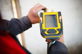 Handheld XRF analyzer spectrometer for scrap metal in action — ストック写真