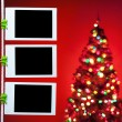 Blank photos on red background with christmas tree — Stock Photo #56823907