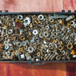 Iron screw nuts in the box — Stock Photo #59883233