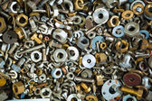 Iron screw nuts background — Stock Photo