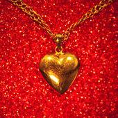 Gold heart pendant — Stock Photo