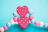 Abstract toy heart shapes on blue background — Stock Photo