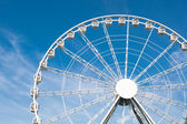 White ferris wheel against blue sky background — Stock Photo
