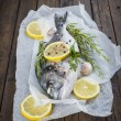 Fresh fish with lemon herbs and spices to cook — Stock Photo #52569767
