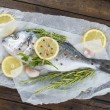 Fresh bream fish with herbs and spices ready to cook — Stock Photo #52664101