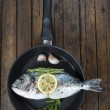 Fresh bream fish with herbs and spices on a pan — Stock Photo #52664151