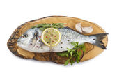 Gilt-head sea bream with spices and herbs — Stock Photo