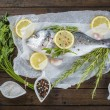 Fresh bream fish with herbs and spices ready to cook — Stock Photo #53449803