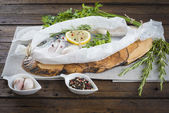 Fresh gilt-head sea bream ready to cook — Stock Photo