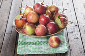 Basket with apples on a wooden table — Foto Stock