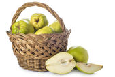 Basket with quinces isolated on white background — Stock Photo