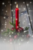 Christmas greeting card with a red candle — Stok fotoğraf