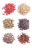 Different kinds of pepper on a white background — Stock Photo