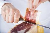 Professional cutting of serrano ham — Photo