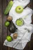 Fruits and vegetables with a glass of green smoothie — Stock Photo