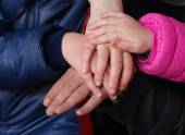 Family holding hands together — Stock Photo