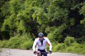 """NATIONAL PARK GALICICA,MACEDONIA -JUNE 21, 2015:Bicycle Tour """"Tour de Galichitsa"""" was organized by the cycling-Mountain Bike Club Prespa. The tour is held the second year, participants had  the opport — Stock Photo"""
