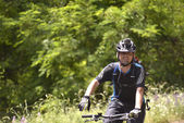 "NATIONAL PARK GALICICA,MACEDONIA -JUNE 21, 2015:Bicycle Tour ""Tour de Galichitsa"" was organized by the cycling-Mountain Bike Club Prespa. The tour is held the second year, participants had  the opport — Stock Photo"