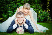 Happy young wedding couple on picnic — Stock Photo