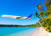 Jet plane over the tropical sea  — Stock Photo