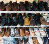Lots of shoes on sale — Stock Photo