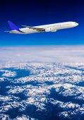Airplane over mountains — Stock Photo