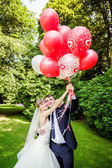 Couple posing   with balloons — Foto Stock