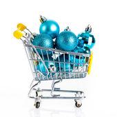Shopping cart full of christmas balls — Stock Photo