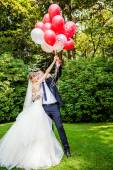 Couple posing   with balloons — Stock Photo