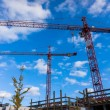 Building cranes on constraction — Stock Photo #60583023