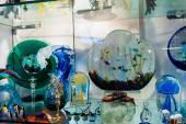 Murano glass on display in window — Stock Photo