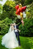 Beautiful couple with balloons — Stock Photo
