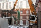 Heavy dredger demolishes building — Stock Photo