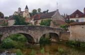 Stone bridge and medieval buildings — Stock Photo
