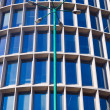 Lamppost and windows of the facade of the modernist building — Stock Photo #71038783
