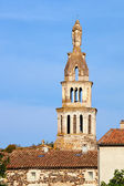 Figure on the bell tower of the medieval church — Stock Photo
