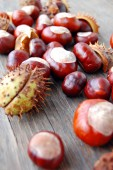 Chestnuts on wooden table — Foto Stock