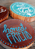 Closeup of Badges with words, honest friend, eat pray love — Stock Photo