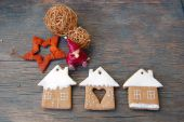 Christmas background with ornaments and gingerbread cookies on wooden table — Stock Photo