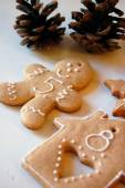 Christmas background with ornaments and gingerbread cookies on white wooden table — Stock Photo